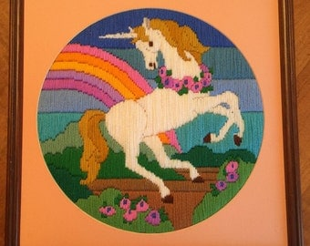 Professionally framed and matted needlepoint unicorn and rainbow