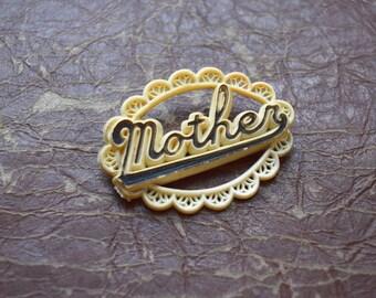 Vintage Mother Pin Oval Plastic Filigree