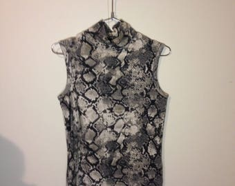 snake print sleeveless turtle neck