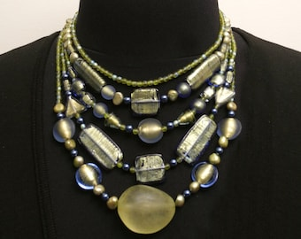 One of a Kind Multi-strand Necklace with Unusual Gold and Blue Shimmer Beads in a Variety of Shapes and Sizes. 5 Strands Hang beautifully.