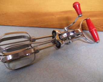 Vintage Superwhril egg beater by Turner and Seymore Manufacturing