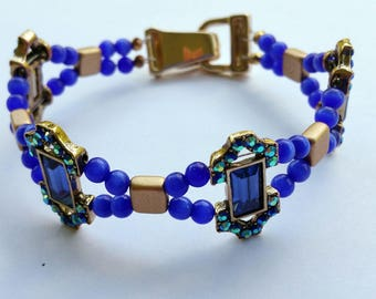 Cobalt blue and gold bracelet with gold fold over magnetic clasp
