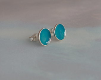 Silver earrings in petrol blue colored pure geometric cool summery undulation with vibrant color and reflections