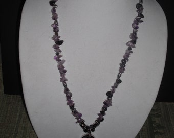 Lavender and silver long necklace with pendant.