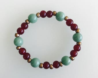 Turquoise, burgundy and gold stretchy beaded bracelet
