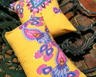 Pack of four beautiful yellow scatter cushions
