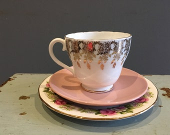 Bone china tea cup saucer and side plate