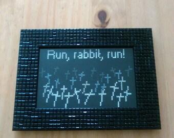 "Run, rabbit, run! House of 1000 Corpses cross stitch. 6""x4"" simple black frame"