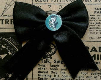 Repurposed black satin hair bow with vintage kitty cat print