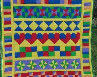 Hand quilted lap size quilt