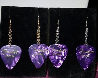 Purple tortoise shell guitar pick earrings.