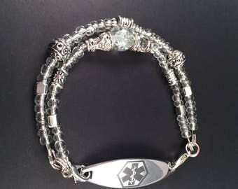 Interchangeable medical ID bracelet.                                        Clear with crackle and antique silver beads