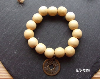 N1212 Medium Size Cream Colored Wooden Beaded Bracelet with Chinese Good Luck Charm