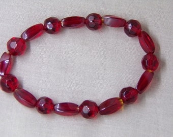 B1261  Red Round and Oblong Glass Beaded Bracelet.