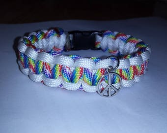 paracord rainbow bracelet,with peace sign charm..gay pride!