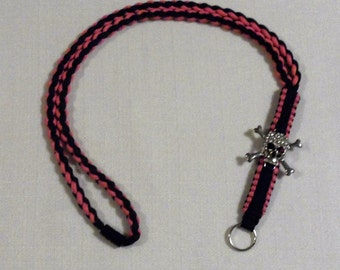 Handmade pink and black skull lanyard.