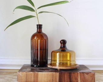 Vintage amber  glass and wooden cheese  board and bell jar
