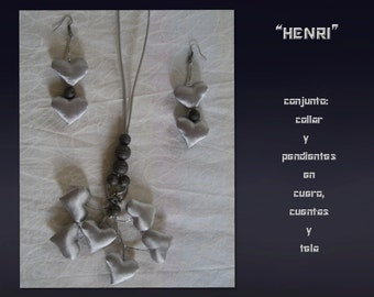 Henri. Set necklace and earrings in leather beads and fabric.