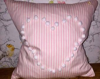 Pink striped pom pom cushion