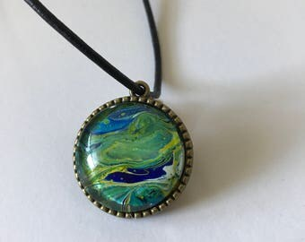 Green and blue tree of life pendant.
