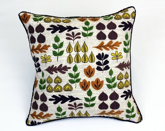 Decorative pillow crafted from vintage barkcloth and new designer fabric.