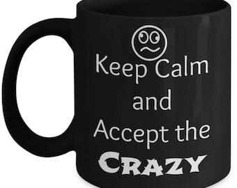Keep Calm and Accept the Crazy black coffee mug