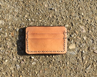 Leather card wallet with dark trim