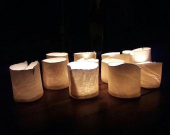 Tealight candle holder made of porcelain with glaze inside
