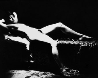A very cool gift is a black and white image of a naked 'woman on couch' from 'The Shadow Line ' (1976)