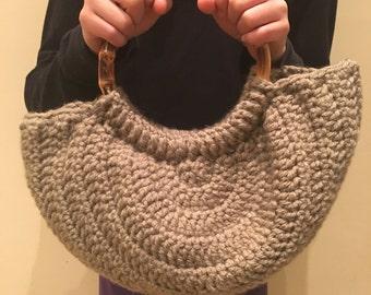 Crochet handbag with bamboo handle