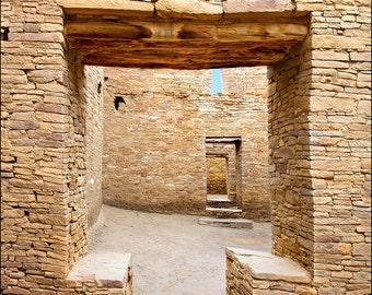 Native American ancient stone walls at Chaco Canyon ruins in New Mexico showing interesting T shaped door. Architectural door photography.