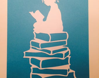 Girl reading a book papercut (Blue)