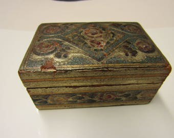 Small wooden box covered in leather