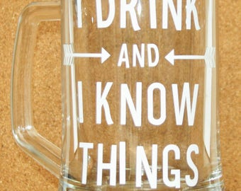 Glass tankard with white vinyl decal. I drink and I know things