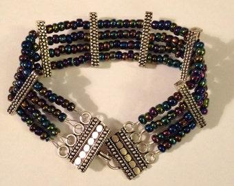 Purple Metallic 4 Strand beaded Bracelet