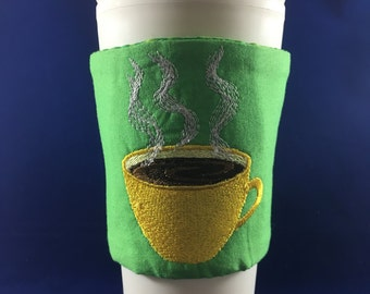 Insulated coffee cozies. Embroidered with a fun design. Keep those fingers safe!
