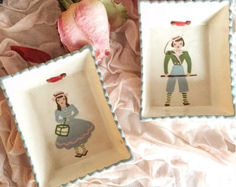 Cleminsons pottery boy and girl wall plaques