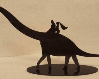 Couple Riding Dinosaur Wedding Cake Topper