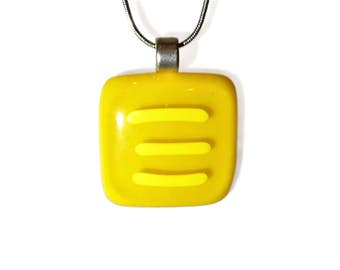 Yellow fused glass pendant with contrasting yellow stripes