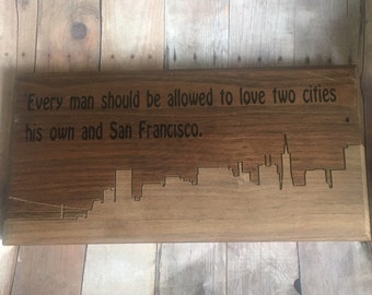 Sign wall every man should allowed to love two cities his own and San Francisco