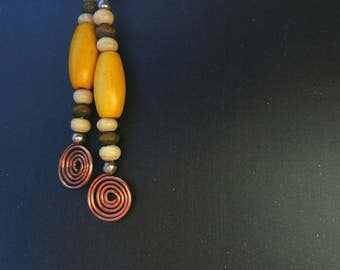 Copper spiral earrings, with wooden beads