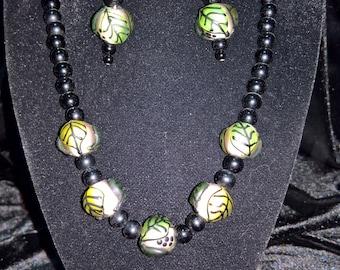 BLACK, WHITE, GREEN leaf motif