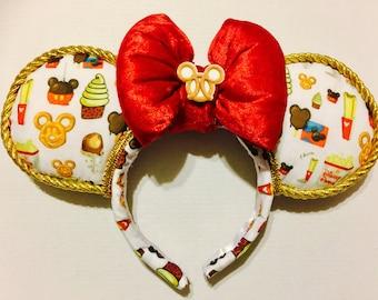 Disney Parks Snacks earsRed puffy bow with Mickey pretzel plannar. Gold trim.