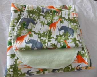Baby Zoo animals on green reciving blanket with burp cloth's