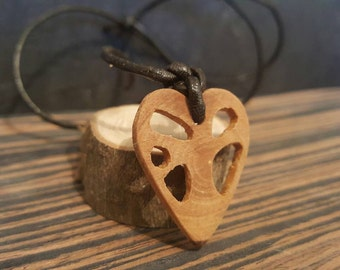 Hand carved tree of life heart pendant