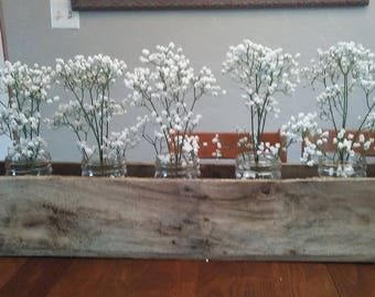 Pallet flower box with canning jars and baby's breath.