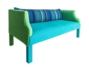Bright Green and Blue Two Seater Sofa with Cushion.