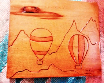 hot air balloon carved on basswood