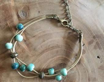 Happy beads bracelet - cream colored wax cord