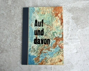 On and of which notebook DinA5 World Atlas travel book